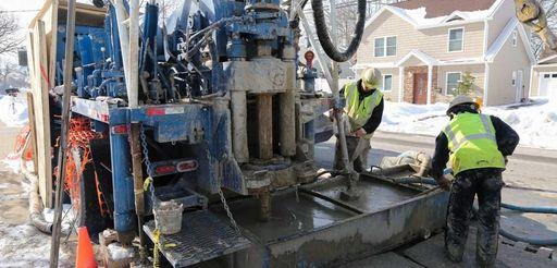Northrop Grumman contractors drill at the corner of