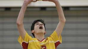 Chaminade's James Walsh serves the ball in the