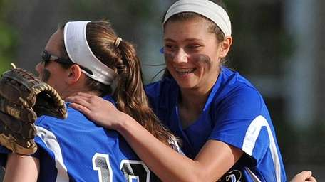 Long Beach shortstop Kelsey Larson, left, gets a