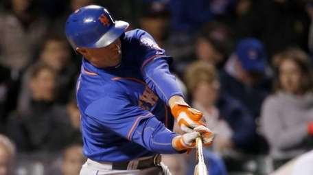 The New York Mets' Michael Cuddyer grounds out