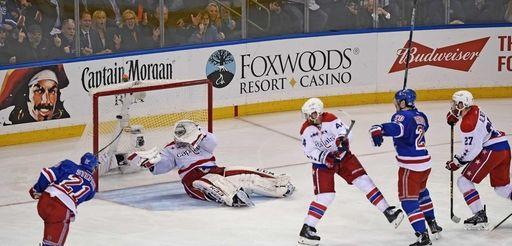 New York Rangers' Derek Stepan scores on Washington