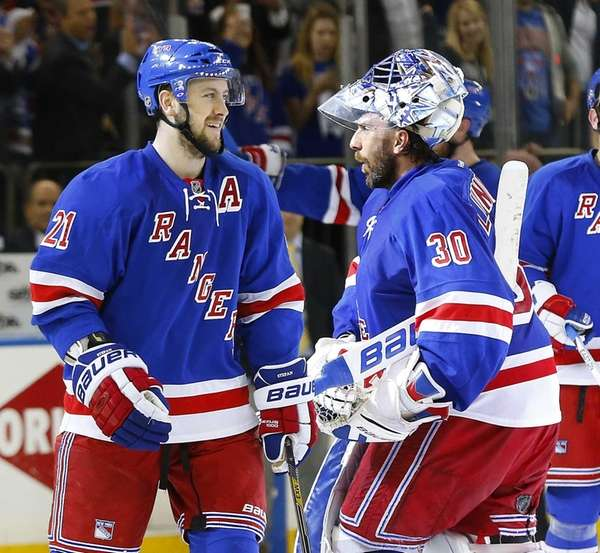 Derek Stepan and Henrik Lundqvist of the New