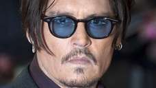 Johnny Depp arriving for the British premiere of