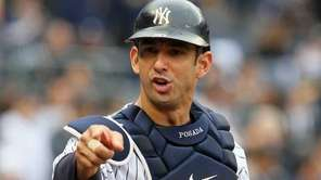 Jorge Posada gestures towards the dugout against the