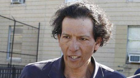 Hector Bejarano, 53, of East Meadow, is escorted