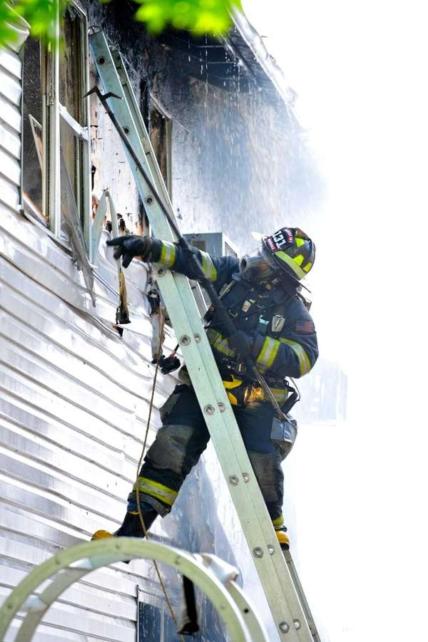 Four firefighters were hurt while battling a house
