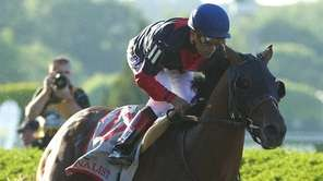 Tonalist, ridden by jockey Joel Rosario, wins the