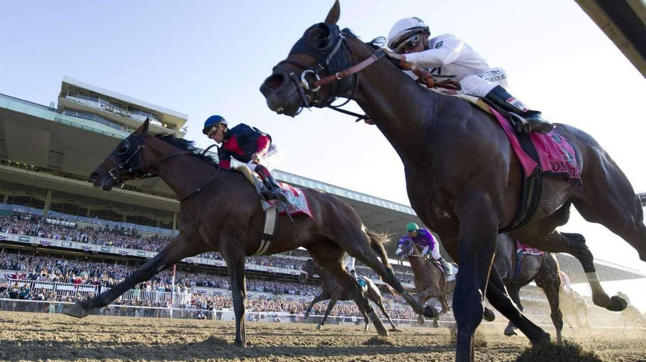 Winner Tonalist, left, ridden by Joel Rosario, and