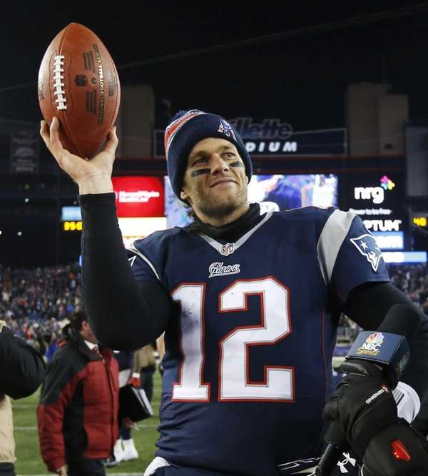 New England Patriots quarterback Tom Brady holds up