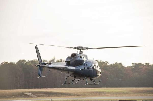 A helicopter departs from the East Hampton Town