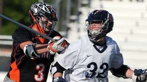 Manhasset's Tyler Dunn gets defended by Carey's Tommy