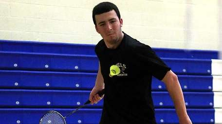 Half Hollow Hills' Riley Cavanagh hits the forehand