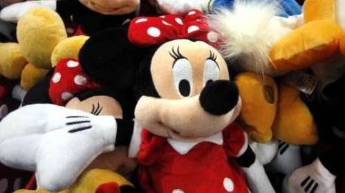 Disney characters are piled up in a display