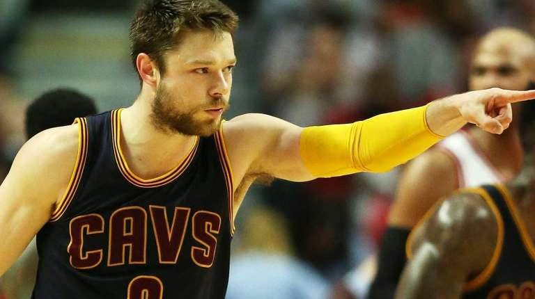 Matthew Dellavedova of the Cleveland Cavaliers reacts in