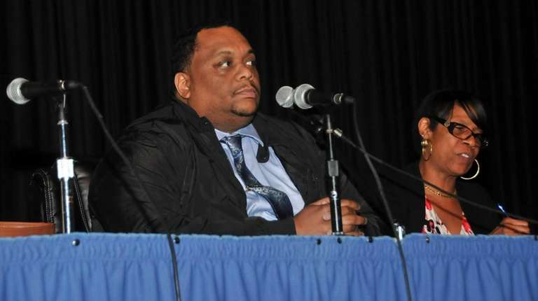 Hempstead School Board President Lamont Johnson, left, with