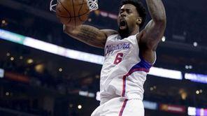 Los Angeles Clippers center DeAndre Jordan, left, dunks