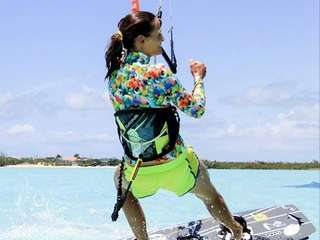 Nicole Miller's latest neoprene rash guards look as