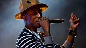 Pharrell Williams in his famous hat, performing at