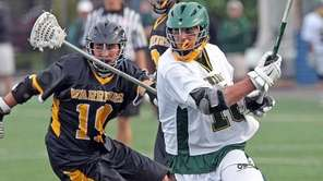 Lynbrook's Owen Daly keeps the ball during a