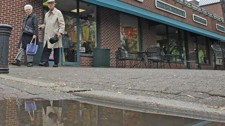 Clara and Joe, of Garden City, are reflected