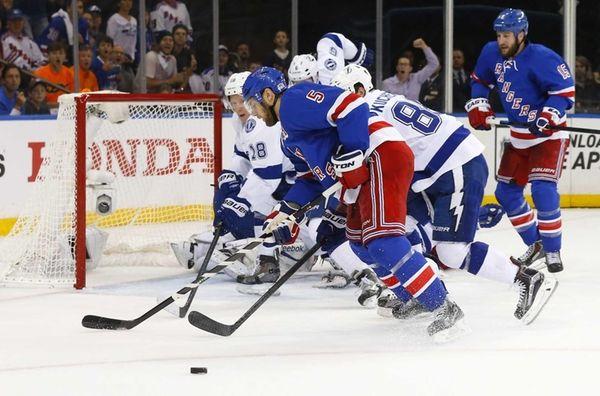 Dan Girardi of the New York Rangers misses