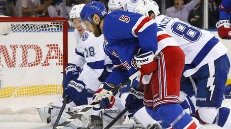 Dan Girardi of the New York Rangers misses