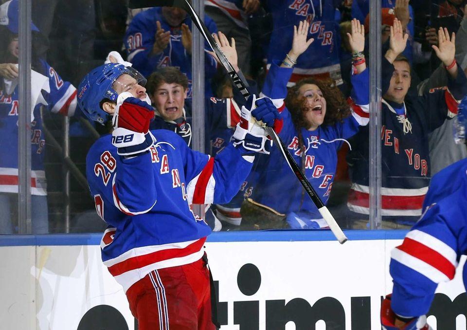 Dominic Moore of the New York Rangers celebrates