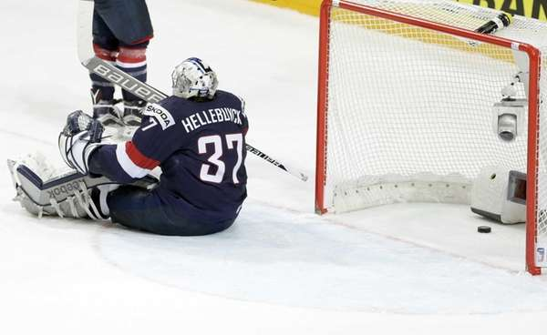 Goalkeeper Connor Hellebuyck, of the United States, reacts