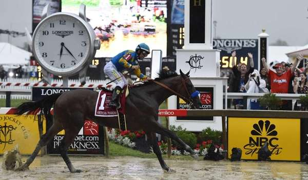 American Pharoah, ridden by Victor Espinoza, wins the
