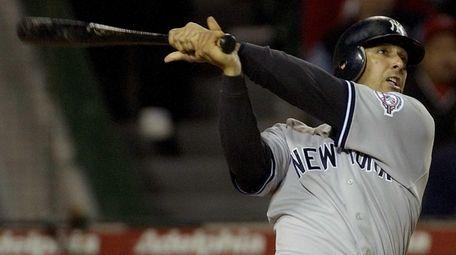 New York Yankees' Jorge Posada follows through on