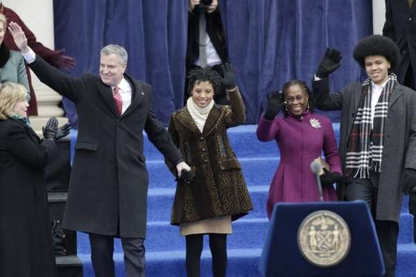 New York City Mayor Bill de Blasio waves
