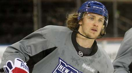 Carl Hagelin skates during the Rangers' practice at