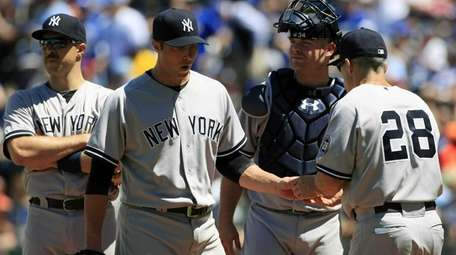 New York Yankees pitcher Chris Capuano, second from
