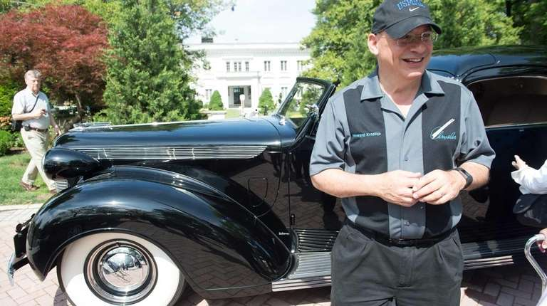 Howard Kroplick shows off a Chrysler that belonged
