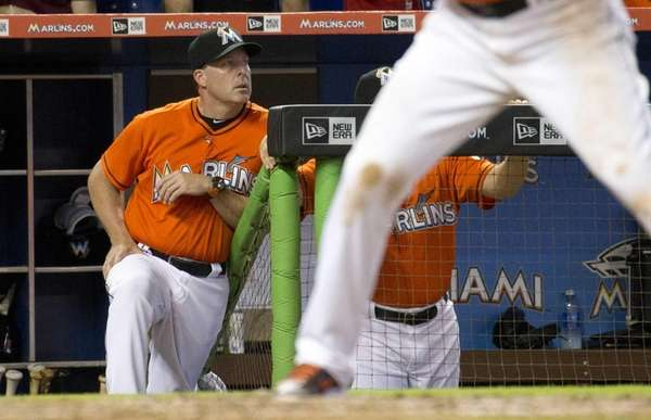 Miami Marlins manager Mike Redmond stands in the