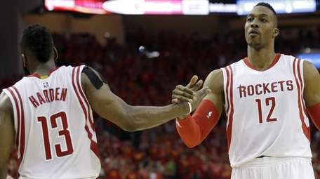 Houston Rockets guard James Harden (13) and center
