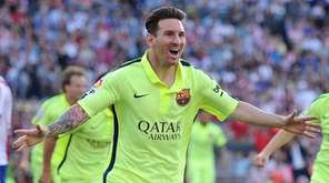 Lionel Messi of FC Barcelona celebrates after scoring
