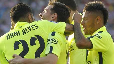 Barcelona's Lionel Messi, second from left, celebrates with