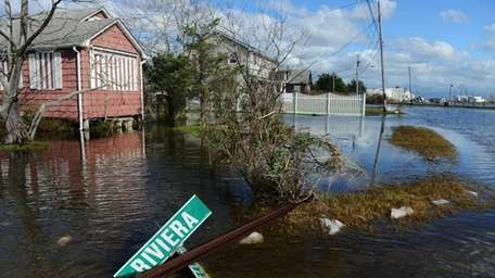 Flooding, debris and damage from the storm surge