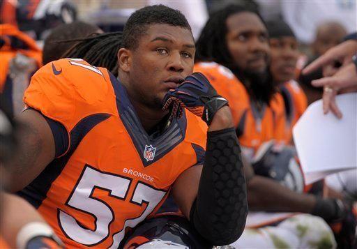 Denver Broncos linebacker Adrian Robinson looks on against