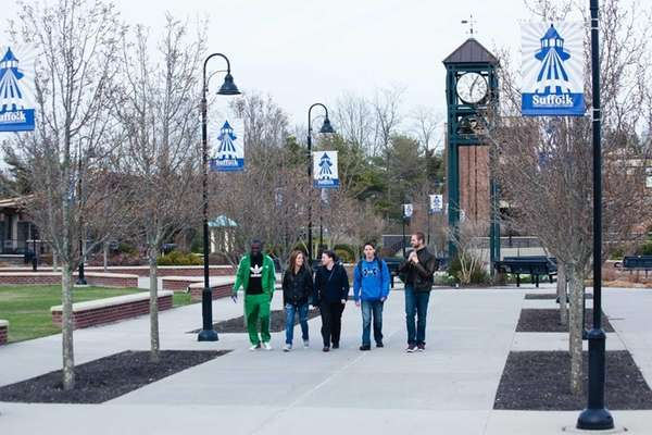 Students walk across the campus of Suffolk County
