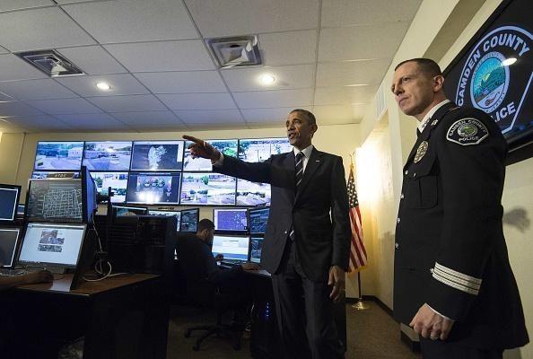 President Barack Obama listens to Camden police Chief