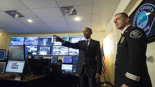 President Barack Obama listens to Camden police Chief