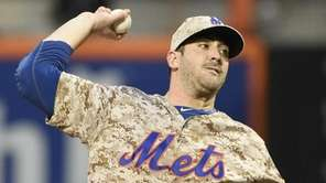 New York Mets starting pitcher Matt Harvey delivers