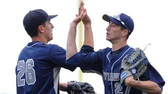 St. Dominic starting pitcher Reiss Knehr, left, celebrates