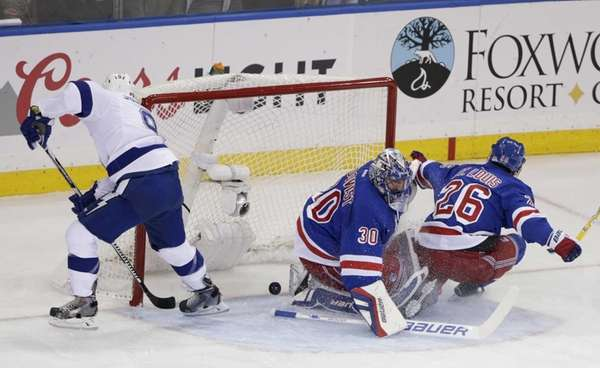 Tampa Bay Lightning center Tyler Johnson, left, scores