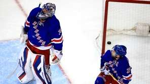 Henrik Lundqvist #30 and Martin St. Louis #26