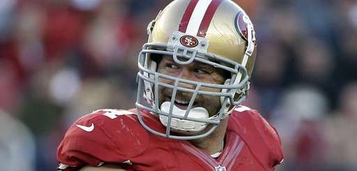 San Francisco 49ers defensive tackle Justin Smith smiles