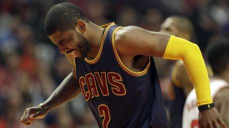Cleveland Cavaliers guard Kyrie Irving (2) grimaces during