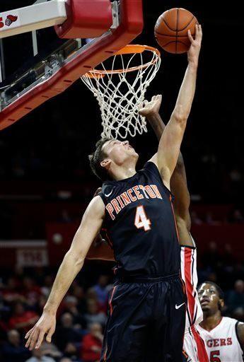 Princeton forward Denton Koon (4) takes a shot